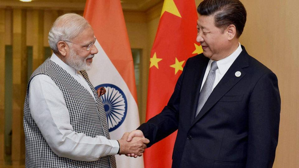 Prime Minister Narendra Modi shakes hands with Chinese President Xi Jinping during a meeting in Tashkent on the sidelines of SCO Summit.