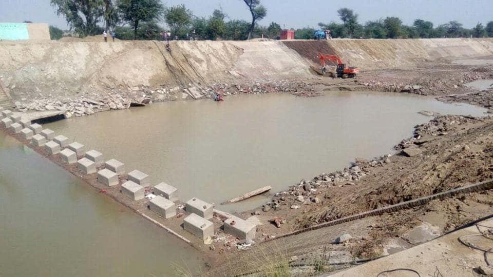 Repair works going on at Indira Gandhi Feeder canal.