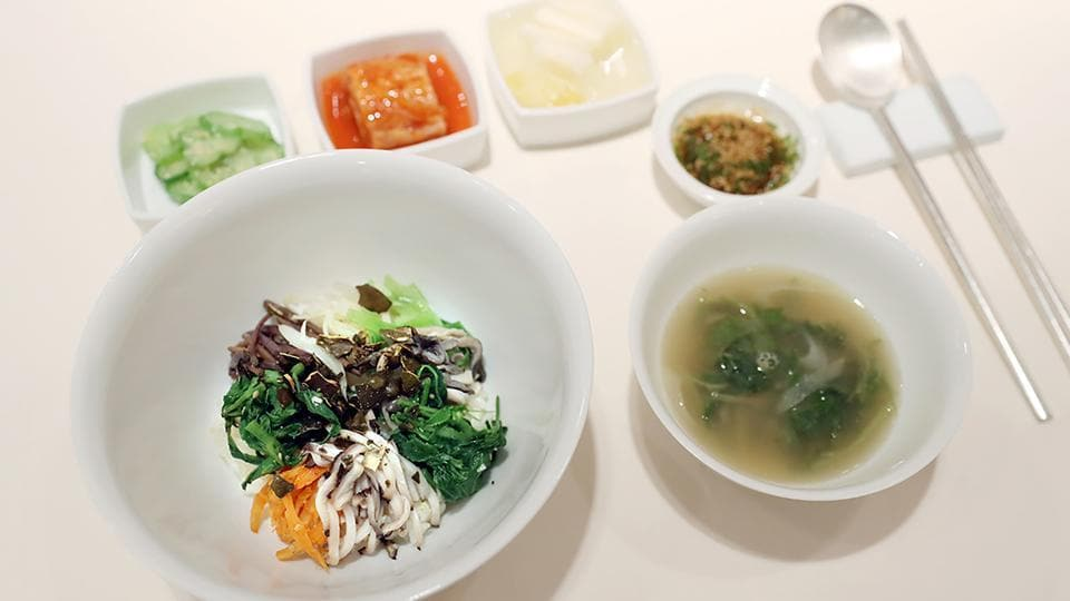 Bibimbap, a dish traditional to both North and South Korea, featuring various vegetables mixed with rice, and banchan sides, will be served at the upcoming inter-Korean summit. Symbolism will be the main course of the banquet at Friday's summit, Seoul revealed Tuesday, with a menu featuring Pyongyang's signature dish and food from the home towns of the South's leaders at previous meetings. (The Blue House / AFP)