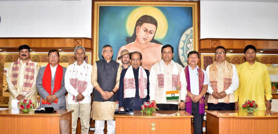 Assam governor Jagdish Mukhi (centre)and chief minister Sarbananda Sonowal (4th from right)pose for a photograph with new ministers after the swearing-in ceremony, at Raj Bhawan in Guwahati on Thursday.