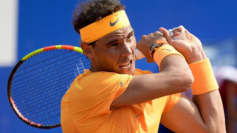 Spain's Rafael Nadal returns the ball to Guillermo Garcia Lopez  during their Barcelona Open match on Thursday.
