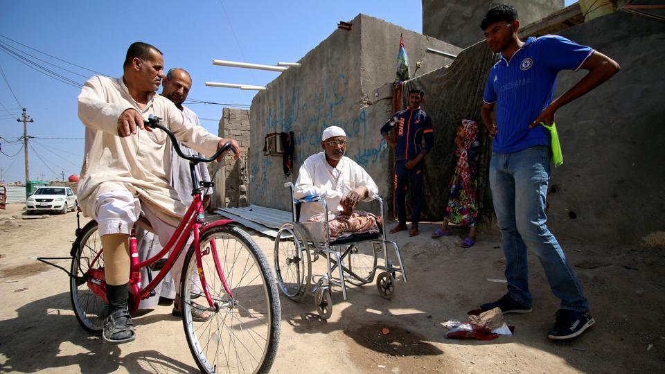 Rafed, a man disabled by a landmine explosion, rides his bicycle in the village. In 1991, the village, like the rest of Iraq, descended deeper into poverty as a result of international sanctions imposed on the country following the occupation of Kuwait. (Essam Al-Sudani / REUTERS)
