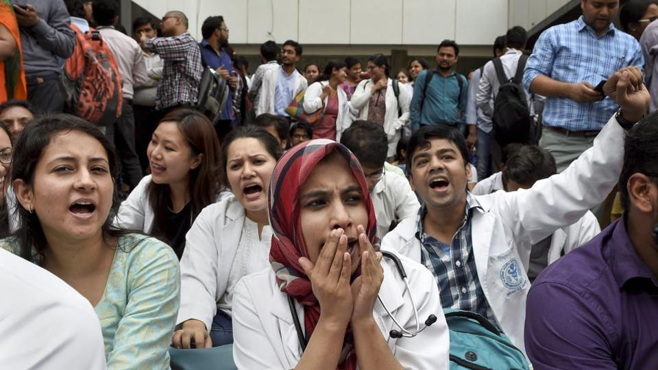 Resident doctors of All India Institute of Medical Sciences (AIIMS) raise slogans during an indefinite strike after a colleague was assaulted by a senior doctor, in New Delhi. (Kamal Singh / PTI)