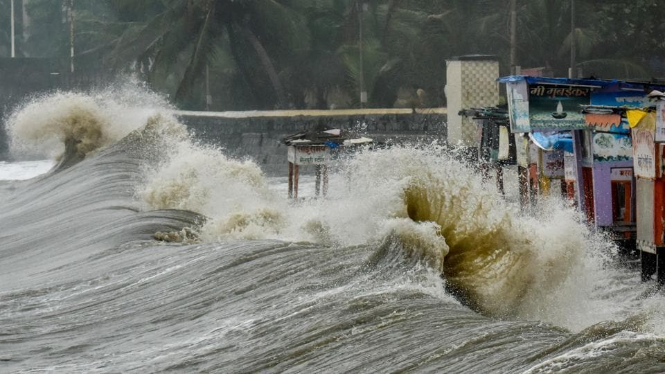Waves during high tide hit the food stalls at the Arabian Sea promenade, Dadar in Mumbai.