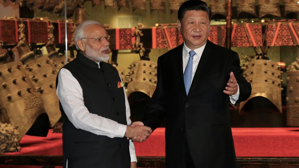 Chinese President Xi Jinping and Prime Minister Narendra Modi shake hands as they visit the Hubei Provincial Museum in Wuhan.