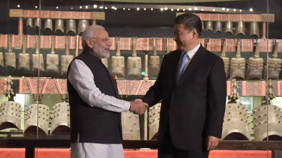 Chinese President Xi Jinping (right) shakes hands with Indian Prime Minister Narendra Modi during their visit at Hubei Provincial museum in Wuhan, China.