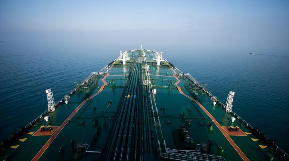 The crude oil tanker 'Devon' sails through the Persian Gulf towards Kharq Island to transport crude oil to export markets in the Persian Gulf, Iran, on Friday, March 23, 2018. Geopolitical risk is creeping back into the crude oil market. Photographer: Ali Mohammadi/Bloomberg