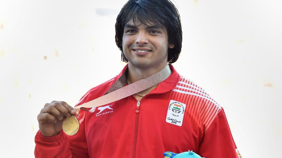 Neeraj Chopra celebrates after receiving his gold medal at the podium ceremony of men's javelin throw event during the 2018 Commonwealth Games (CWG 2018) in Gold Coast, Australia.