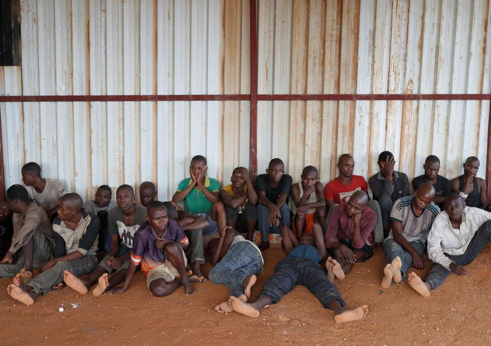 Detained Mai-Mai Yakutumba rebels, captured by Congolese soldiers from the Armed Forces of the Democratic Republic of Congo (FARDC) sit on the ground in Namoya, Maniema Province, eastern Democratic Republic of Congo, April 26, 2018.