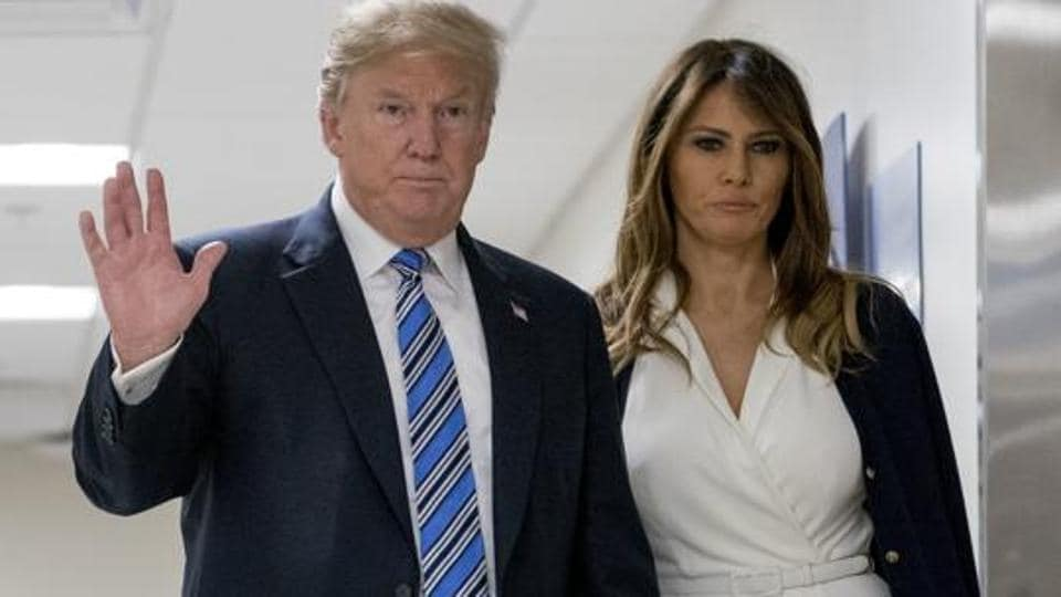 President Donald Trump, center, accompanied by first lady Melania Trump.