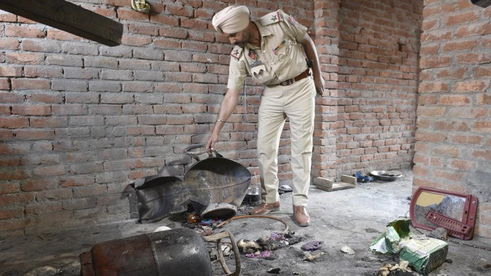 Police personnel investigating the spot after LPG cylinder blast in Giaspura locality, Ludhiana, on Thursday morning.