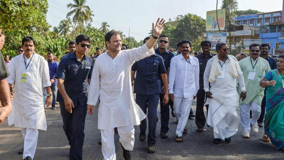 Congress president Rahul Gandhi waves at his party supporters during a campaign ahead of Karnataka Assembly elections 2018 in Honnavar on Thursday.