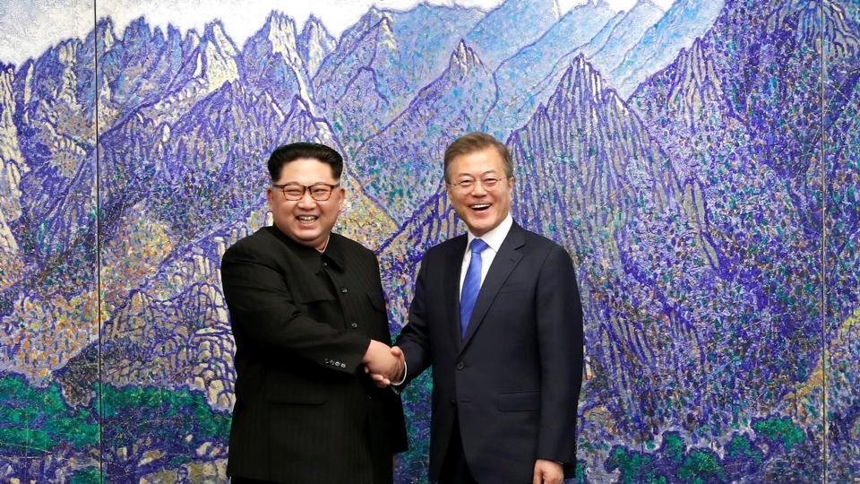 South Korean President Moon Jae-in (R) shakes hands with North Korean leader Kim Jong Un during their meeting at the Peace House at the truce village of Panmunjom inside the demilitarised zone separating the two Koreas, in South Korea, on Friday.