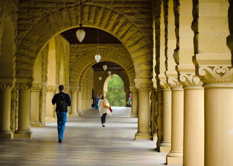 Students walk underneath a covered walkway at the Stanford University campus on their way to classes. Eminent institutions such as Harvard and Stanford reserve a place of pride for their liberal arts programmes.