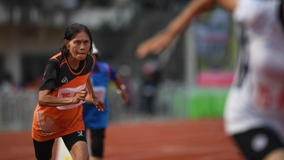 An elderly woman in the 75-80 age category starts the 400-metre race during Thailand's first national Elderly Games in the northern Thai province of Nan. Competitors who gathered in northern Nan province defied age stereotypes and the searing sun in the government-backed sporting event, organised to promote an active lifestyle among seniors as Thailand tries to stave off an ageing crisis. (Lillian Suwanrumpha / AFP)