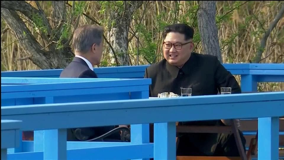 South Korean President Moon Jae-in and North Korean leader Kim Jong Un talk during the inter-Korean summit at the truce village of Panmunjom, in this still frame taken from video, South Korea April 27, 2018.