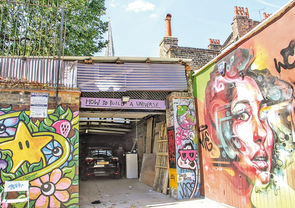 A garage off Brick Lane is decorated with colourful street art