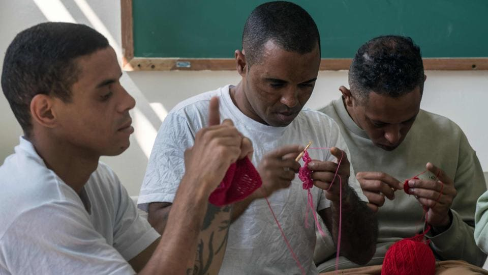 Inmates crochet clothing as part of Ponto Firme project.
