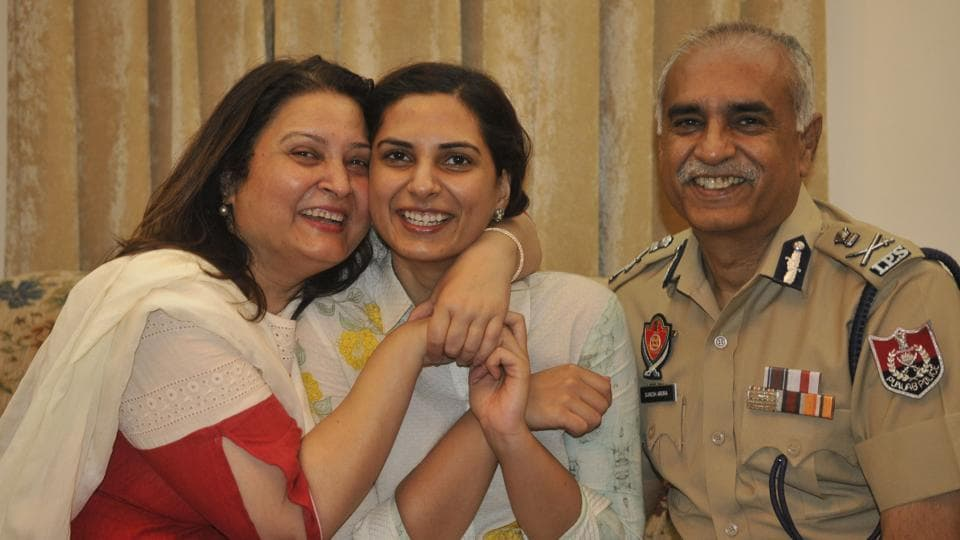 Megha Arora with her father, Punjab DGP Suresh Arora, and her mother in Chandigarh on Friday. This was her third attempt.