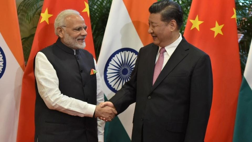 Chinese President Xi Jinping shakes hands with Prime Minister Narendra Modi during their visit at East Lake Guest House, in Wuhan, China, April 27, 2018.