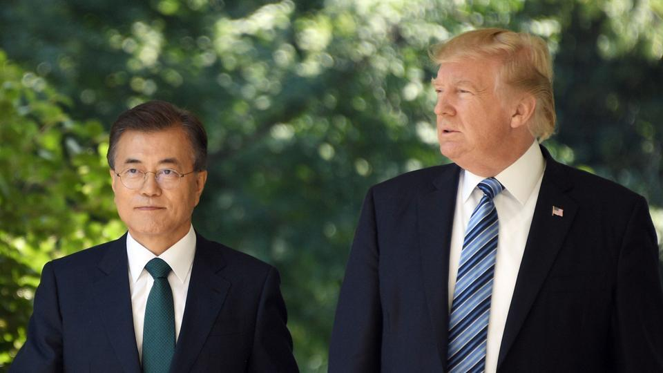 South Korean President Moon Jae-in and US President Donald Trump arrive to give a joint press conference in the Rose Garden at the White House in Washington, DC on June 30, 2017.