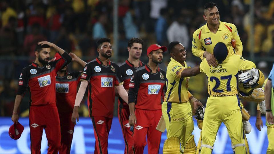 Chennai Super Kings' Harbhajan Singh (R) lifts captain Mahendra Singh Dhoni to celebrate their win in the VIVO IPL Twenty20 cricket match against Royal Challengers Bangalore in Bangalore, Karnataka on April 25, 2018. (Aijaz Rahi / AP)