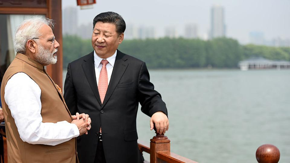 Indian Prime Minister Narendra Modi (L) and Chinese President Xi Jinping looking on in a house boat, at East Lake, in Wuhan.
