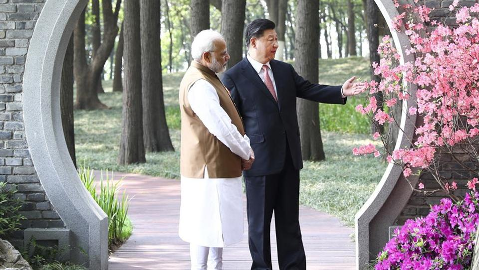 In this photo released by China's Xinhua News Agency, Prime Minister Narendra Modi, left, and Chinese President Xi Jinping talk at a garden in Wuhan in central China's Hubei Province on Saturday, April 28, 2018.