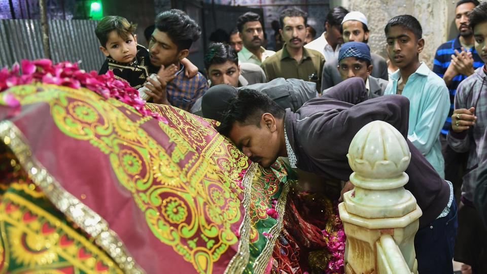 Devotees gather around the grave of Sufi Saint Abdullah Shah Ghazi at his Shrine in Karachi. Embraced widely as a part of Pakistan's national identity, qawwali has played a key unifying role, with city-dwellers and villagers flocking to Sufi shrines for concerts. (Rizwan Tabassum / AFP)