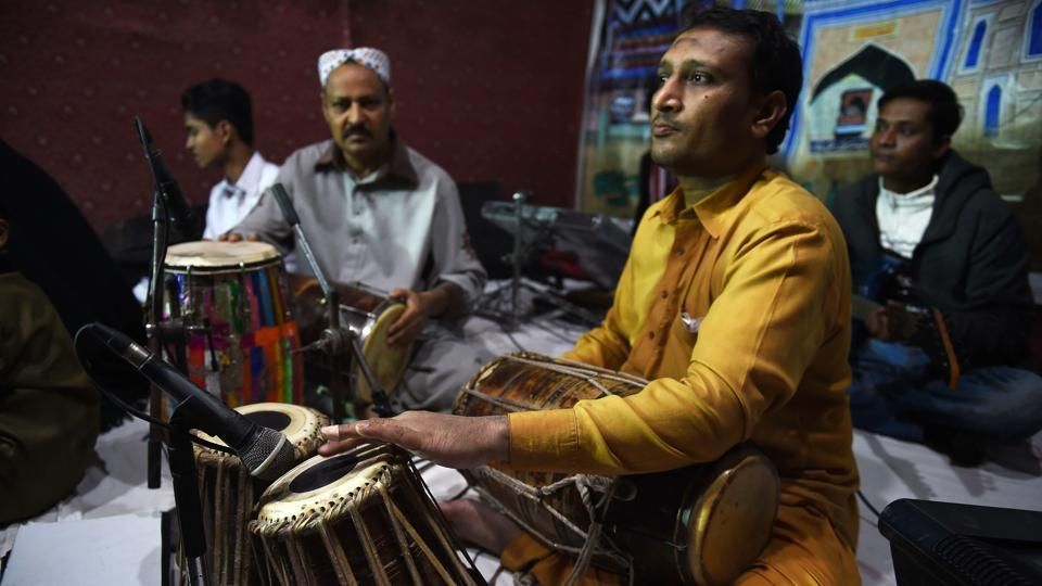 Performances traditionally last hours, with a troupe of musicians interweaving soulful improvisation under lyrical, lilting vocal lines to a steady beat of rhythms on dholak, tabla and hand clapping, sending fans drifting into trance-like transcendent states. (Asif Hassan / AFP)