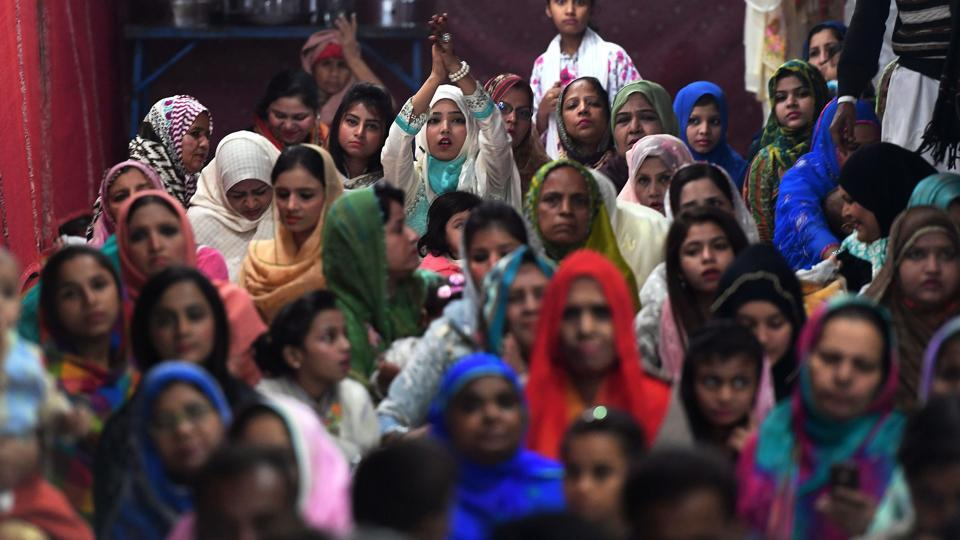 Devotees listen to the Sabri brothers during an event in Karachi. Sectarian militants have targeted Sufis for years. Just months after Sabri was killed, IS claimed back-to-back attacks on shrines in the provinces of Balochistan and Sindh that killed more than 100 people combined. Earlier this month, the military approved death sentences for two militants linked to Sabri's killing.  (Asif Hassan / AFP)
