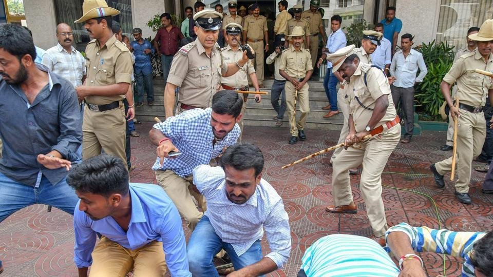 Police attempt to control a protest by the supporters of Karnataka BJP chief's son B Y Vijayendra who failed to get Assembly ticket to contest from Varuna, in Mysuru, Karnataka  on April 24, 2018. (PTI)