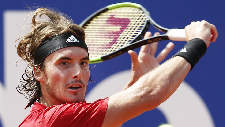 Stefanos Tsitsipas of Greece returns the ball in his semifinal match against Spain's Pablo Carreno Busta at the Barcelona Open Tennis Tournament on Saturday.