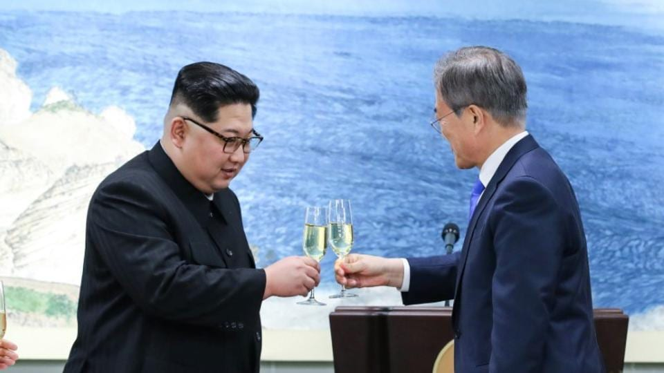 South Korean President Moon Jae-in and North Korean leader Kim Jong Un share a toast at the truce village of Panmunjom inside the demilitarized zone separating the two Koreas, South Korea, April 27, 2018.