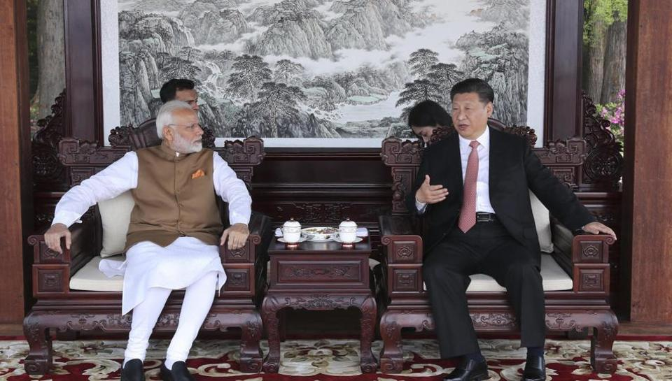 In this photo released by China's Xinhua news agency, Indian Prime Minister Narendra Modi, left, and Chinese President Xi Jinping talk during a meeting in Wuhan in central China's Hubei Province on April 28, 2018.