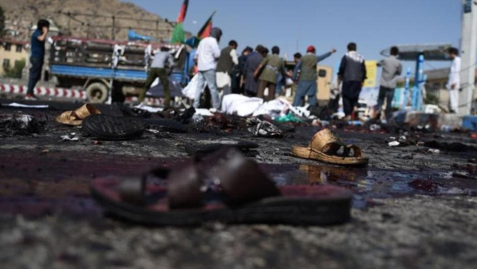The sandals of Afghan protesters seen at the scene of a suicide attack that targeted crowds of minority Shia Hazaras.