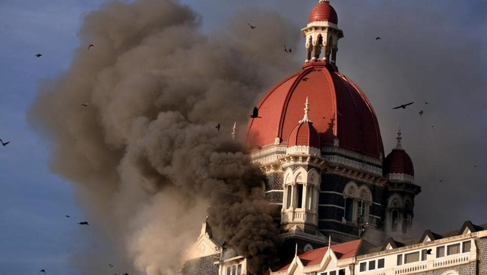 A file photo of smoke belching from below the main dome of Taj Hotel as LeT terrorists carry out coordinated attacks across Mumbai on November 26, 2008.