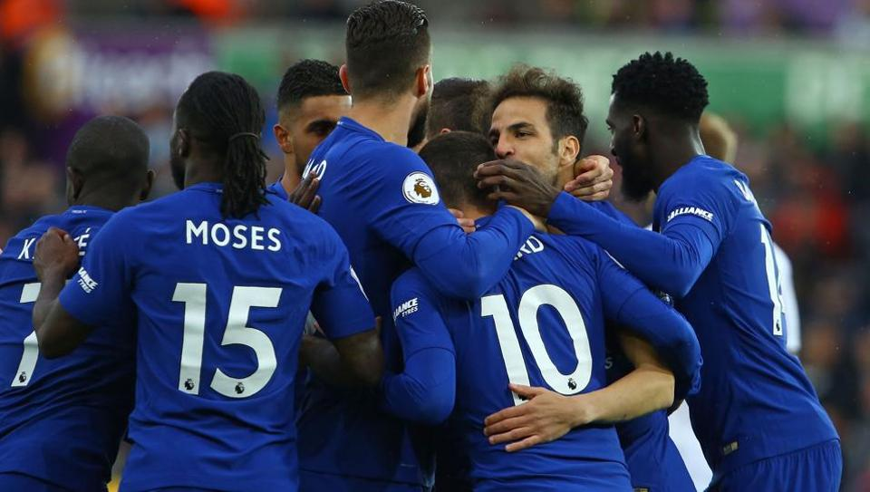 Chelsea midfielder Cesc Fabregas (2nd R) celebrates with teammates after scoring the opening goal of the English Premier League football match vs Swansea City at the Liberty Stadium in Swansea on Saturday.