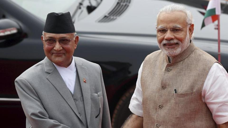 Nepal's Prime Minister Khadga Prasad Sharma Oli (L) shakes hands with his Indian counterpart Narendra Modi during his ceremonial reception at the forecourt of India's Rashtrapati Bhavan presidential palace in New Delhi.