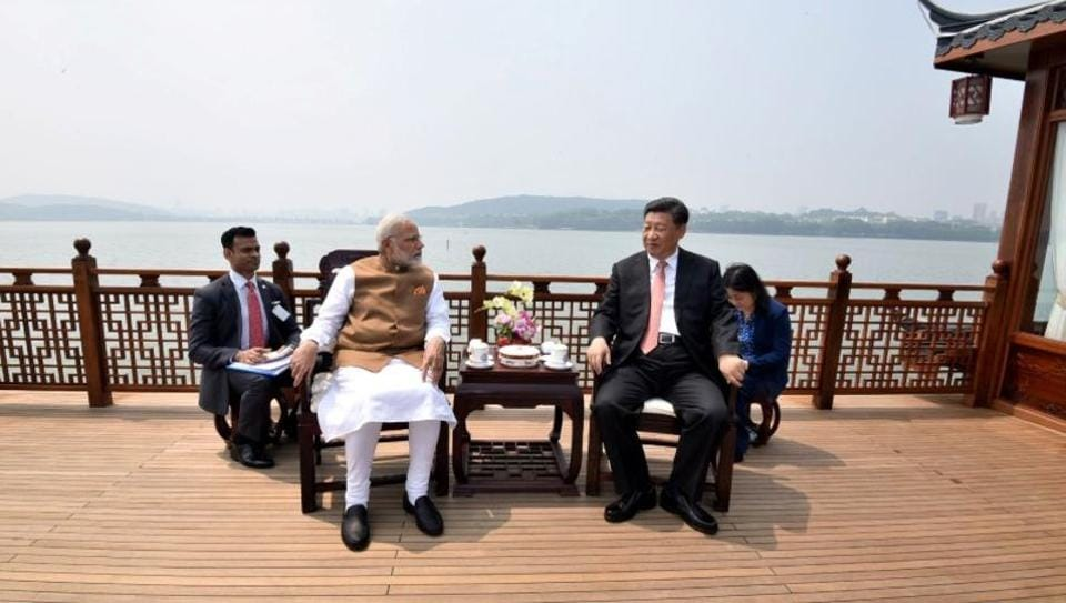 Prime Minister Narendra Modi speaks with Chinese President Xi Jinping as they take a boat ride on the East Lake in Wuhan, China. (PIB / REUTERS)