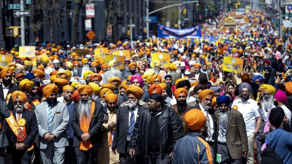 Participants fill Manhattan's Madison Avenue during the Sikh Day Parade, an annual Nagar Keertan (meditation celebration) on Saturday,  in New York.
