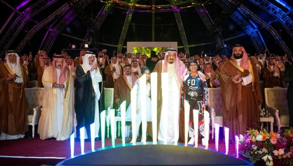 Saudi Arabia's King Salman bin Abdulaziz Al Saud (C) and Crown Prince Mohammed bin Salman (R) attend Qiddiya, multi-billion dollar entertainment resort, launching ceremony in Riyadh, Saudi Arabia April 28, 2018.