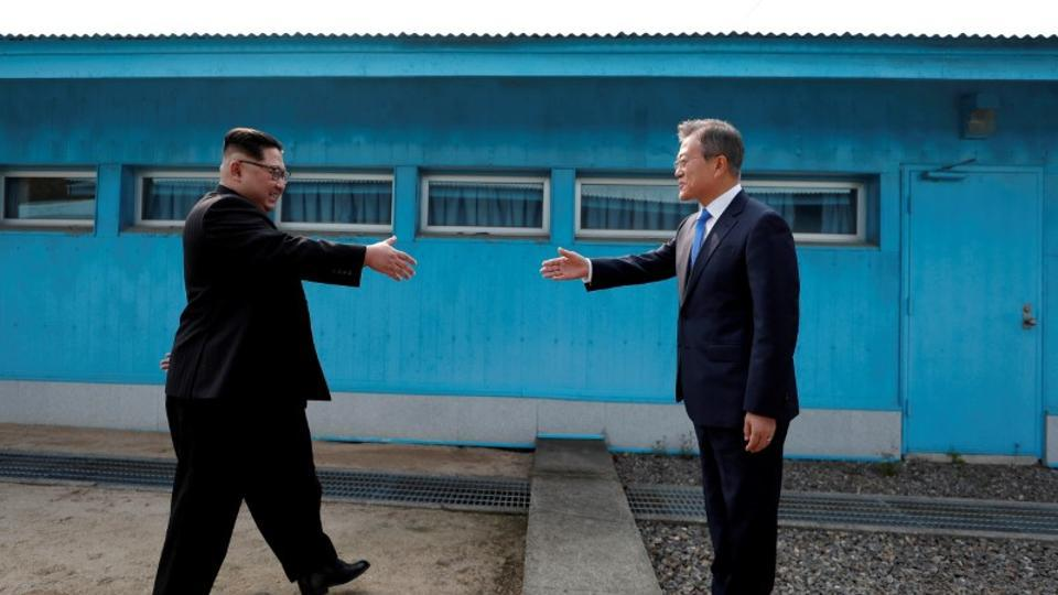 South Korean President Moon Jae-in and North Korean leader Kim Jong Un shake hands at the truce village of Panmunjom inside the demilitarized zone separating the two Koreas, South Korea, April 27, 2018.
