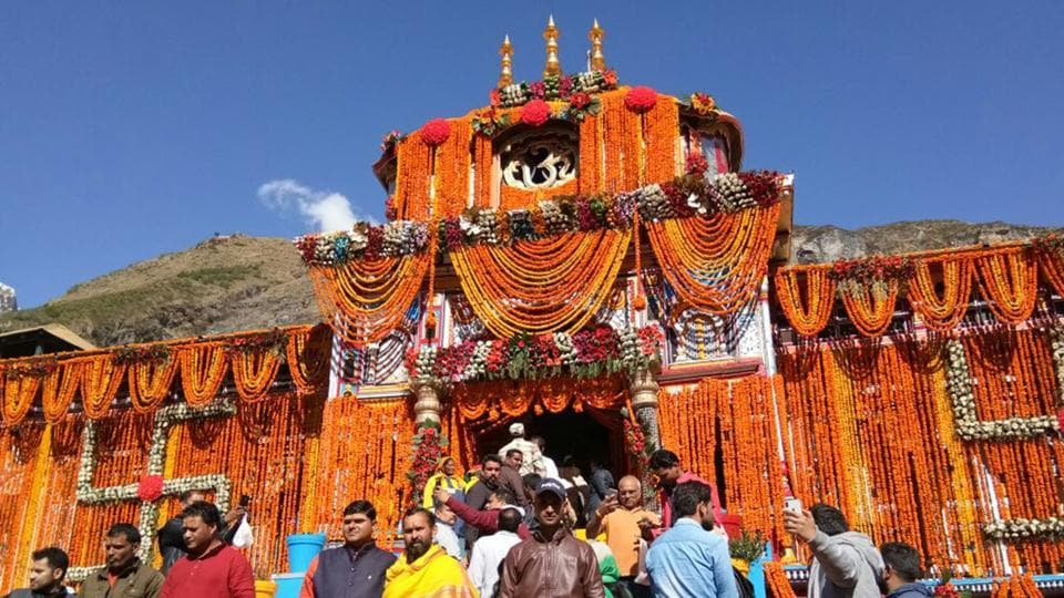 Devotees during opening of the portals of Badrinath shrine on Monday.