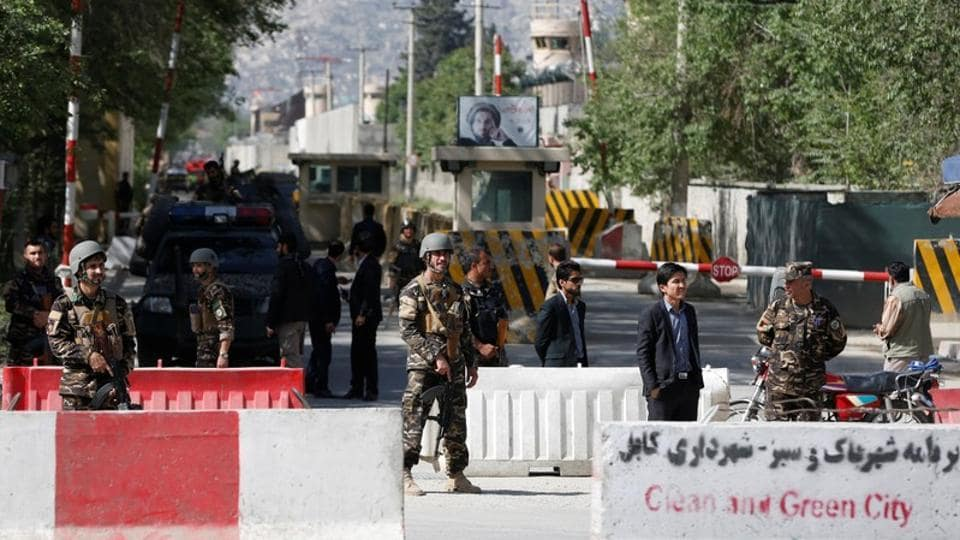 Afghan security forces stand guard near the site of a blast in Kabul, Afghanistan, on April 30, 2018.