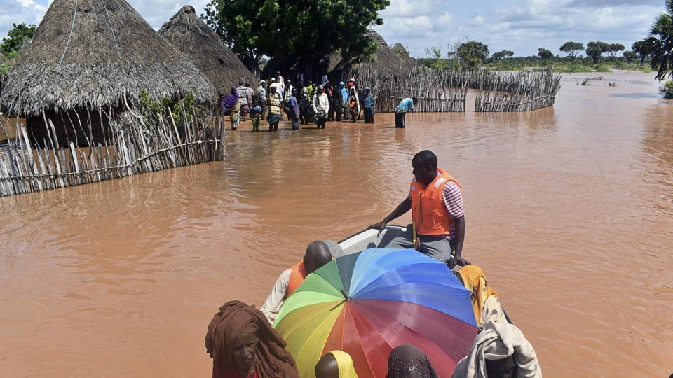 A rescue boat evacuates villagers from their homes, which have been submerged by floods following prolonged heavy rains in Tana Delta, coastal Kenya.