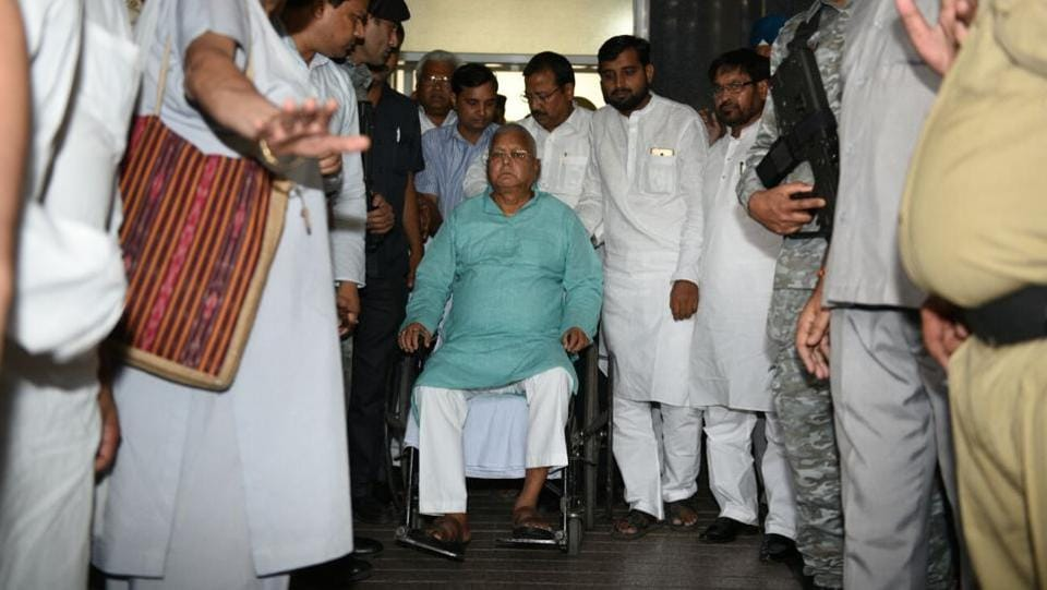 AIIMS decided to refer former Bihar chief minister Lalu Prasad Yadav to the Rajendra Institute of Medical Sciences (RIMS) at Ranchi after a medical board confirmed a marked improvement in his condition. Prasad was being monitored by a team of specialists from the endocrinology, cardiology, nephrology, neurology and surgery departments during his stay at the premier medical institute. (Arvind Yadav / HT Photo  )