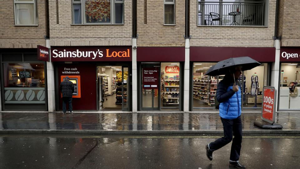 Sainsbury's has agreed to buy Walmart's UK unit, Asda, for 7.3 billion pounds ($10.1 billion) in cash and stock in a deal that would create Britain's largest supermarket chain and marks a profound shift in the country's grocery market.