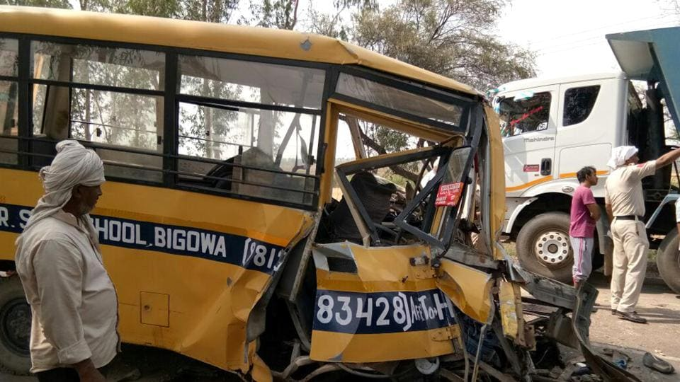 Mangled remains of the school bus that collided with a truck in Charkhi Dadri on Monday.