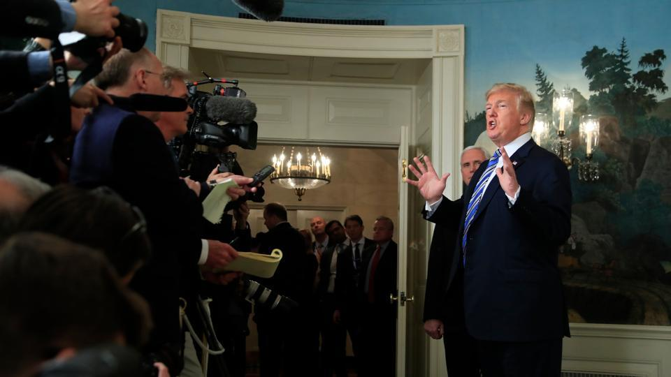 US President Donald Trump responds to reporters' questions in the Diplomatic Room of the White House in Washington on March 23.